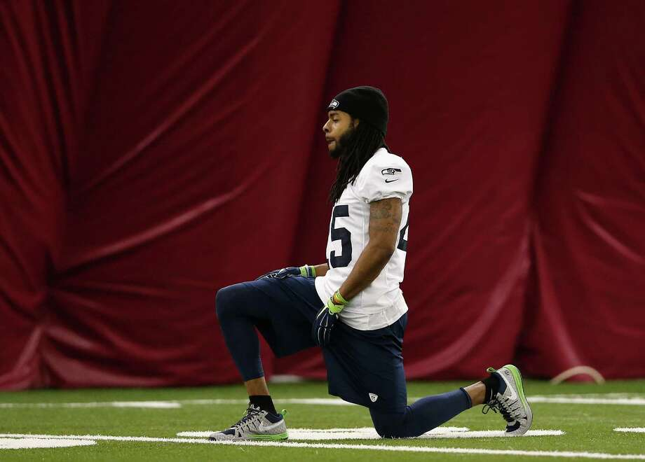 Seahawks cornerback Richard Sherman limbers up Friday while waiting to see which happens first - the Super Bowl or the birth of his baby boy. Photo: Christian Petersen, Staff / 2015 Getty Images
