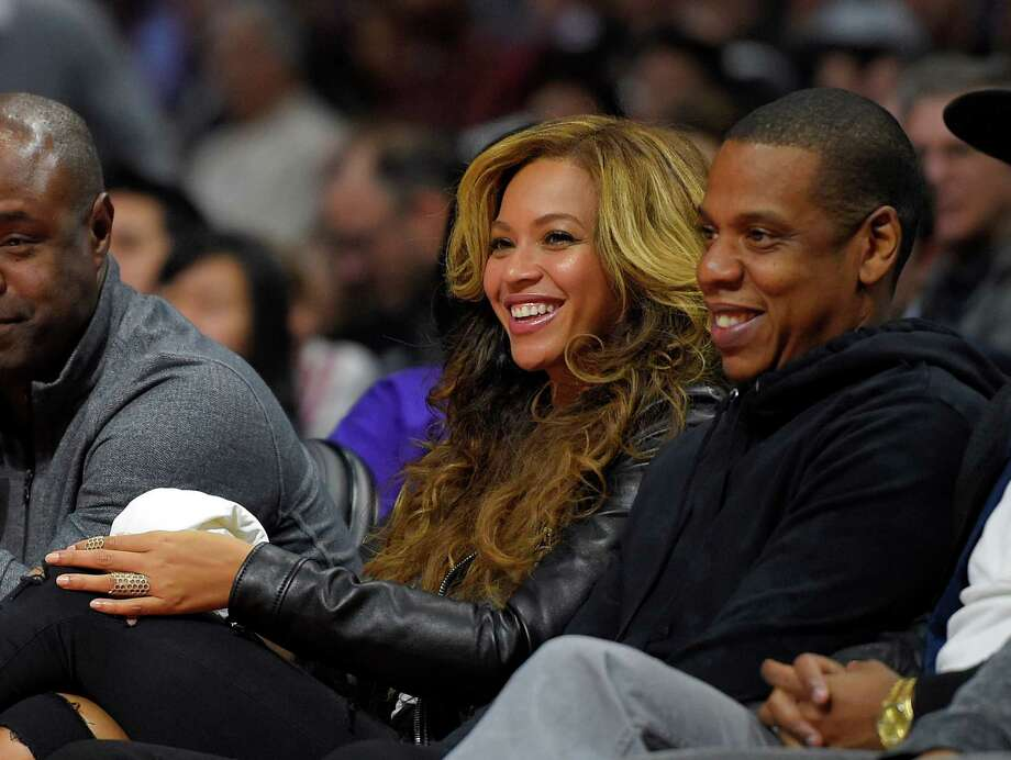 Beyoncé and Jay-Z watch a basketball game in Los Angeles. Photo: Mark J. Terrill, STF / AP