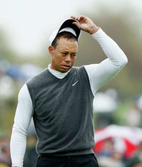 Tiger Woods' 2015 debut ended Friday after he shot an 11-over-par 82 - the worst round of his professional career - and missed the cut at the Phoenix Open. Photo: Scott Halleran, Staff / 2015 Getty Images