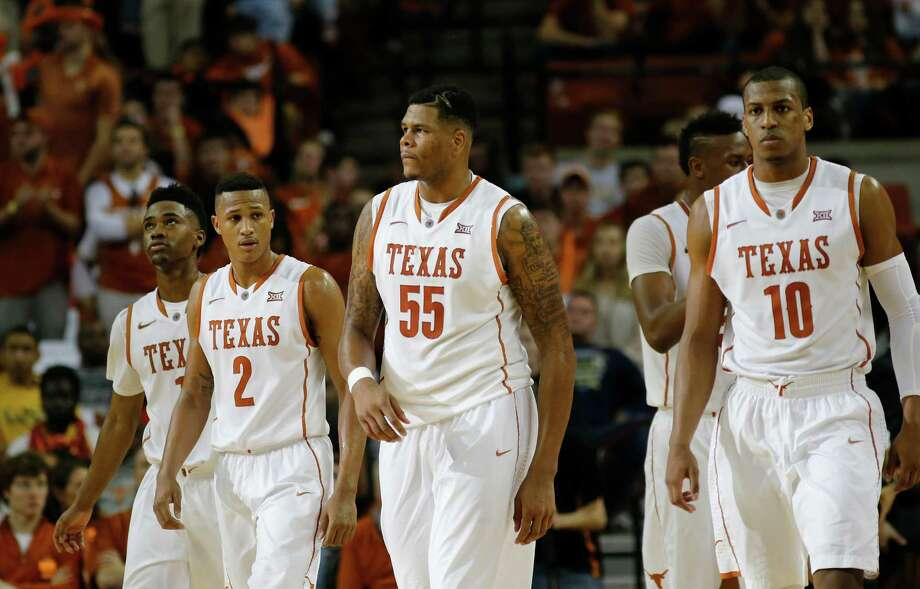It has been a frustrating few weeks for Texas' Demarcus Holland (2),  Cameron Ridley (55) and Jonathan Holmes (10), whose team has lost consecutive games and four of its past six. UT travels to Waco to play Baylor today. Photo: Chris Covatta, Stringer / 2015 Getty Images