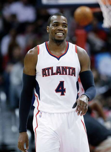 Atlanta Hawks' Paul Millsap smiles as he walks down the court after being called for an offensive foul in the third quarter of an NBA basketball game against the Minnesota Timberwolves, Sunday, Jan. 25, 2015, in Atlanta. Millsap scored 20 points to lead Eastern Conference-leading Atlanta to a 112-100 victory over the Minnesota Timberwolves on Sunday night, extending the Hawks' franchise record with their 16th straight win. (AP Photo/David Goldman) Photo: David Goldman, STF / AP