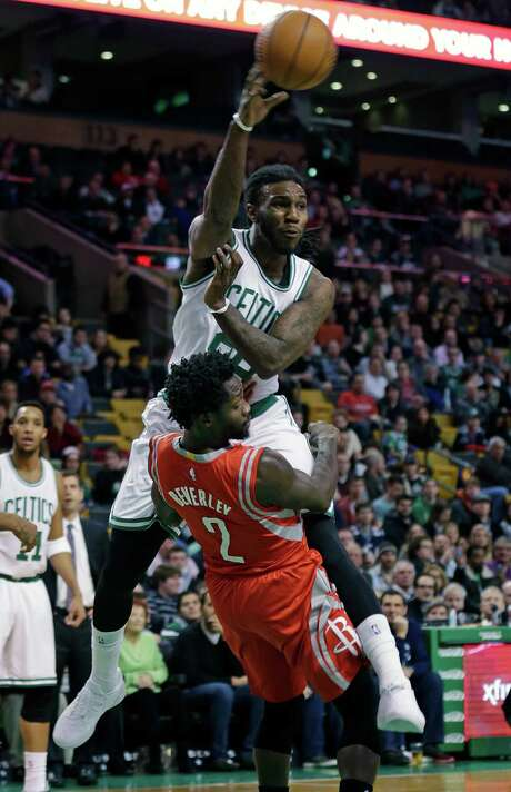 Pat Beverley (2) takes one for the team as the Celtics' Jae Crowder charges into the Rockets guard and gets rid of the ball in the first quarter Friday night. Photo: Charles Krupa, STF / AP