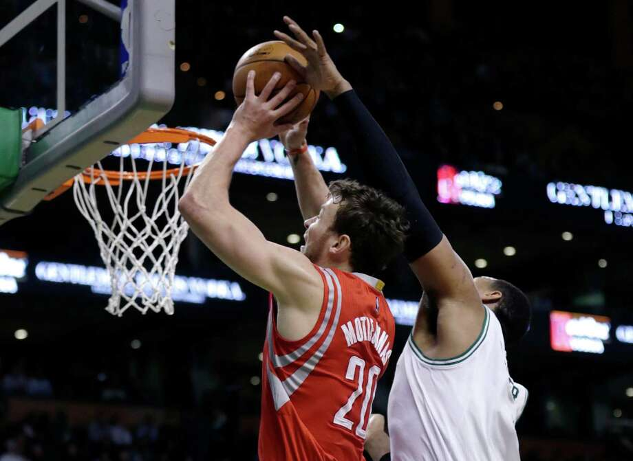 Donatas Motiejunas, left, scored a career-high 26 points Friday against the Celtics, but the rest of the Rockets struggled on offense. Photo: Charles Krupa, STF / AP