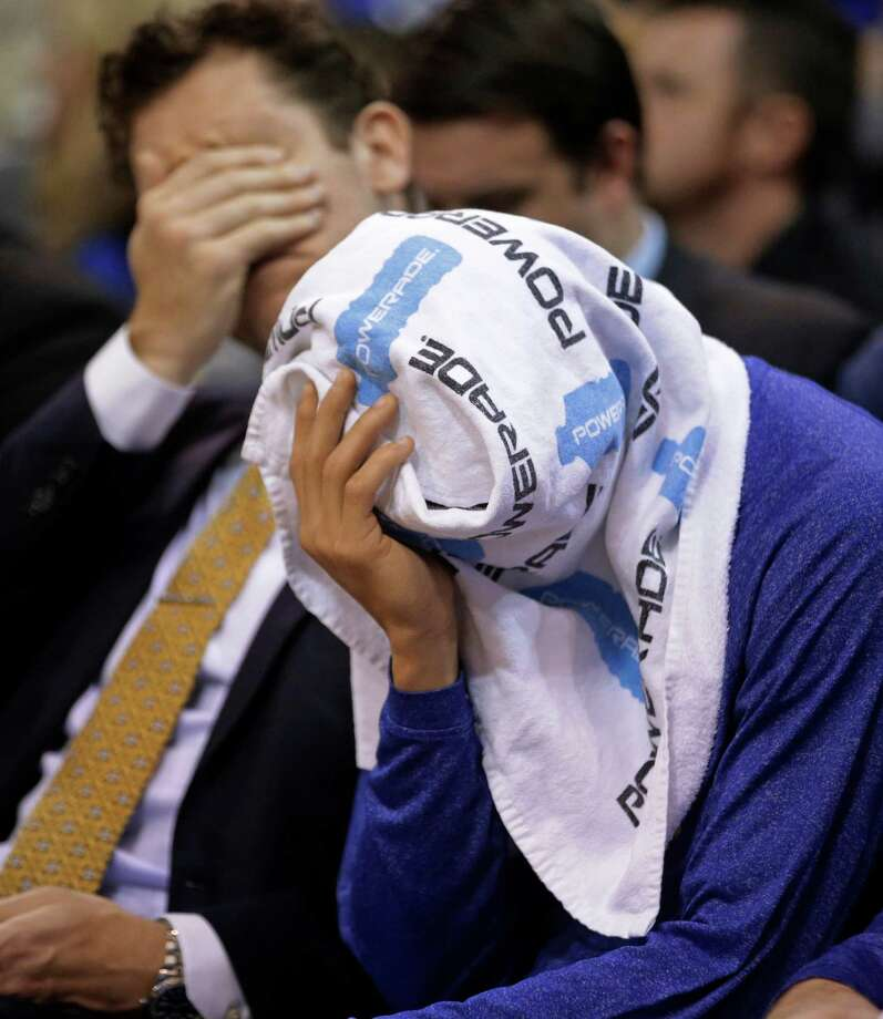 Golden State Warriors guard Stephen Curry covers his head with a towel as he sits on the bench late in the fourth quarter during the Warriors' NBA basketball game against the Utah Jazz on Friday, Jan. 30, 2015, in Salt Lake City. The Jazz won 110-100. (AP Photo/Rick Bowmer) Photo: Rick Bowmer / Associated Press / AP