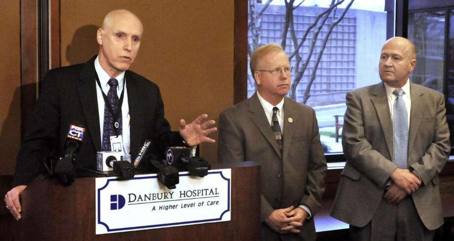 Two people were shot at Danbury Hospital Tuesday afternoon outside the Heart and Vascular Center. Frank Kelly, President and CEO of Danbury Hospital, speaks about the incident at a press conference on Tuesday, March 2, 2010 . At center is Danbury Mayor Mark Boughton and right is Police Chief Alan Baker. Photo: Michael Duffy / The News-Times