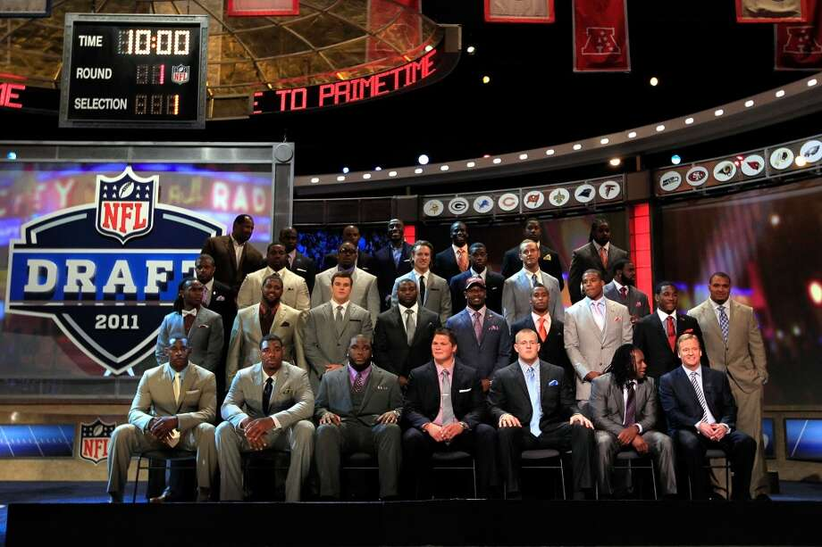 Members of the 2011 first-round draft class, with Texans star J.J. Watt seated third from the right on the bottom row. Photo: Chris Trotman, Getty Images