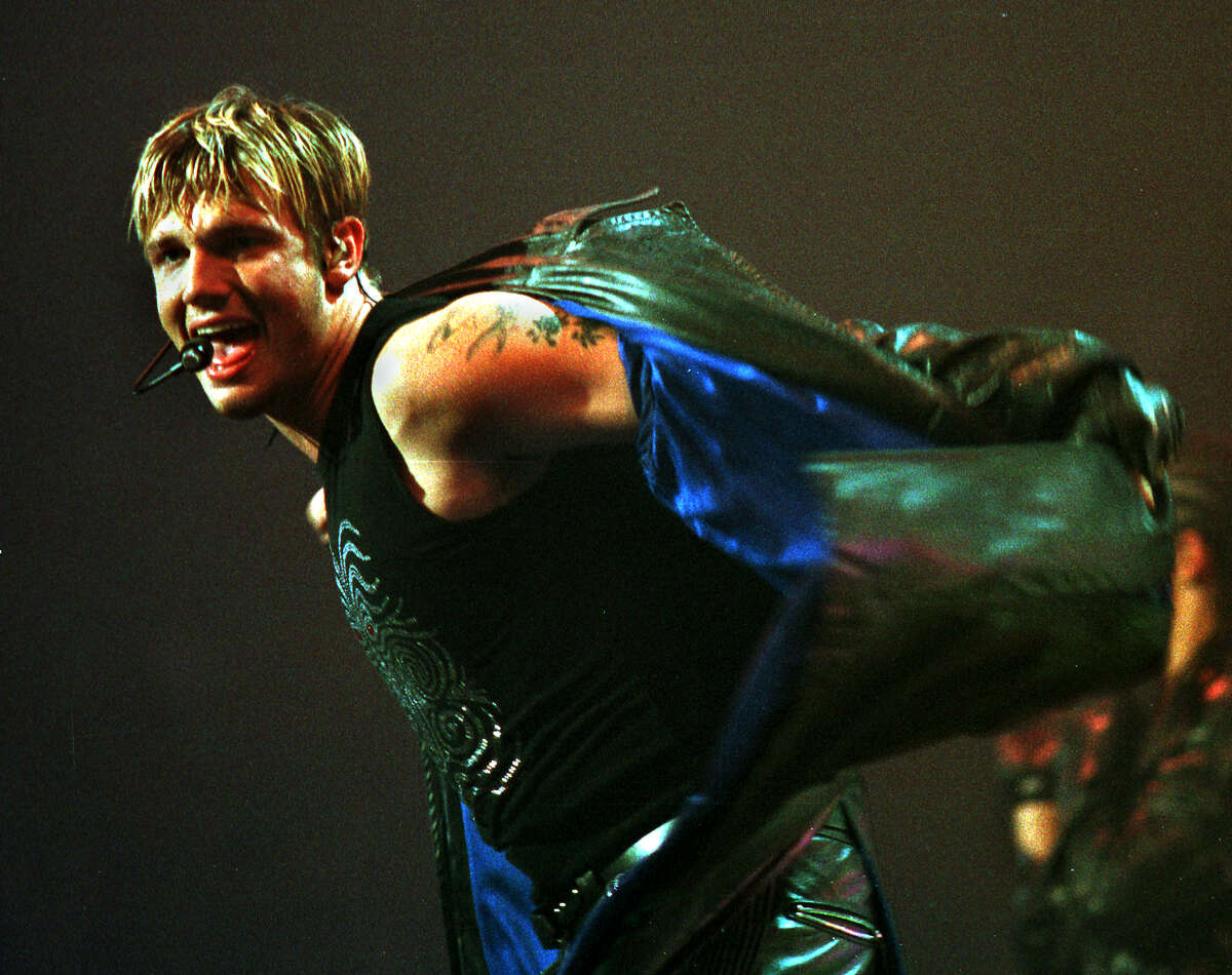 The Backstreet Boys' Nick Carter takes off his jacket while performing at the Pepsi Arena in Albany Saturday, June 30, 2001. (Jonathan Fickies/Times Union)