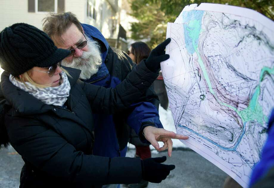 Dawn Fortunato and Otto Lauersdorf point to areas on a map during a meeting about contamination concerns at Booth Court in Greenwich, Conn., on Saturday, January 31, 2015. Photo: Lindsay Perry / Stamford Advocate