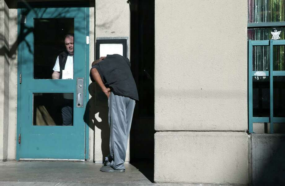 The front door of an apartment building at 430 Turk St., where Mark Jeffrey Andrus reportedly lived. Photo: Paul Chinn / The Chronicle / ONLINE_YES