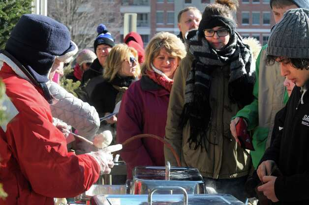 Andy Bentley, left, of Andy's Adirondack Grill serves uo New England clam chowder during the 17th Annual Saratogaa€™s Chowderfest on Saturday Jan. 31, 2015 in Saratoga Springs, N.Y. (Michael P. Farrell/Times Union) Photo: Michael P. Farrell / 00030395A