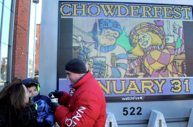 Ashley Nicoletta, left, holds her 5-year-old son Jacob Hadlock as they share a cup of chowder with Bob Martinez during the 17th Annual Saratogaa€™s Chowderfest on Saturday Jan. 31, 2015 in Saratoga Springs, N.Y. (Michael P. Farrell/Times Union) Photo: Michael P. Farrell / 00030395A