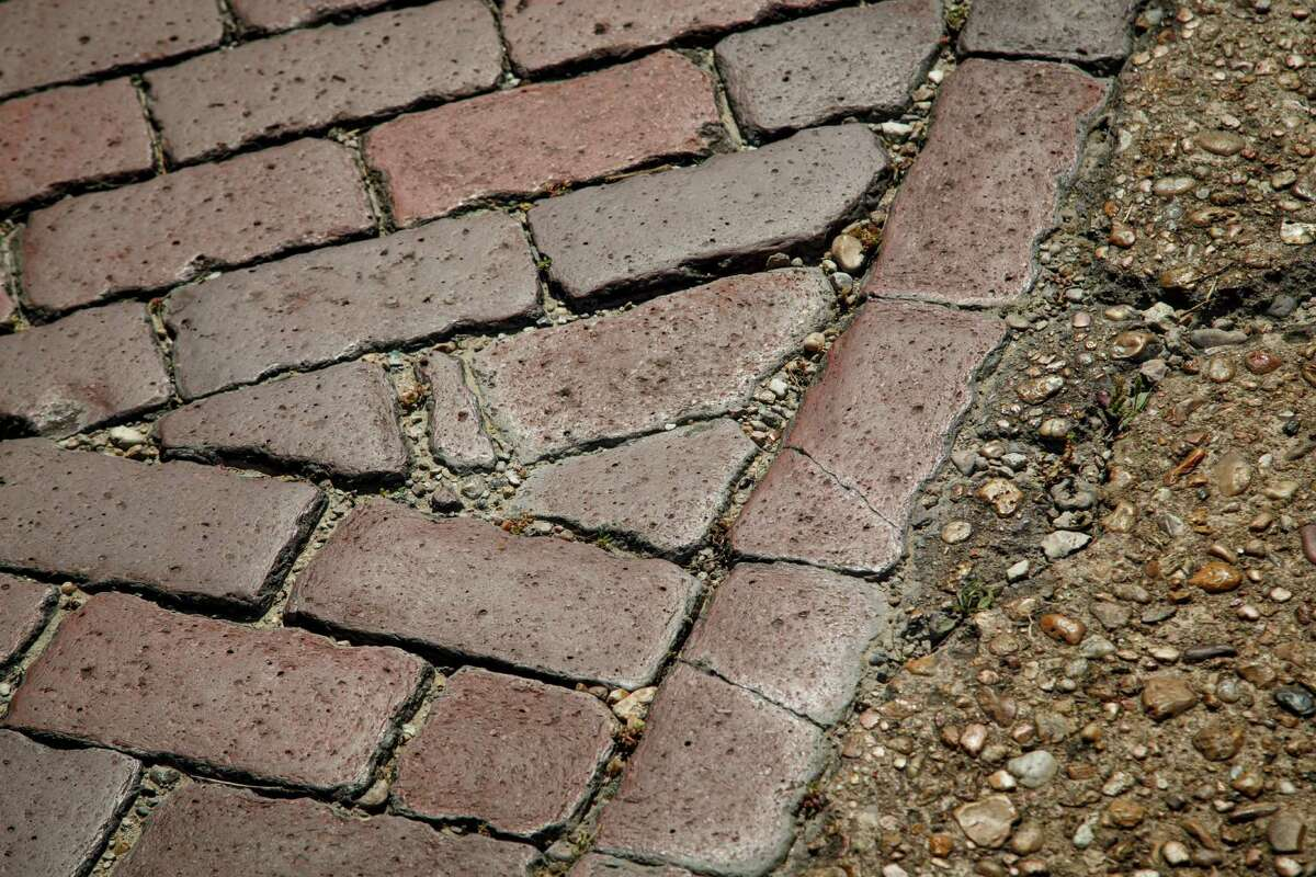 Preservationists believe that bricks lining Freedmen's Town streets should stay exactly where they are.