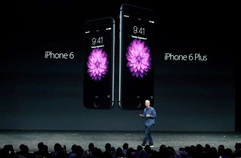 Apple CEO Tim Cook introduces the new iPhone 6 and iPhone 6 Plus on Tuesday, Sept. 9, 2014, in Cuper