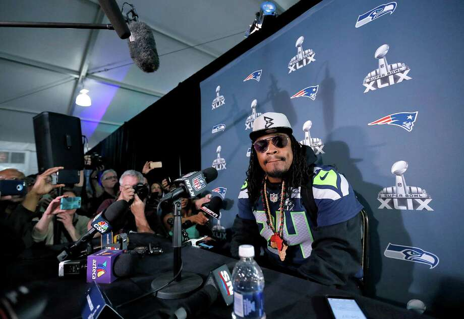 Seattle Seahawks running back Marshawn Lynch was tight-lipped during the rounds of media interviews in the week before Super Bowl XLIX; he prefers to be out of the spotlight and let his play speak for him. Photo: Matt York, STF / AP