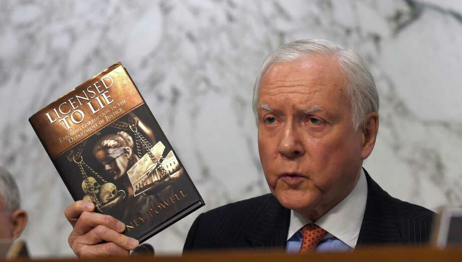 Senate Judiciary Committee member Sen. Orrin Hatch, R-Utah holds up a book as he questions Attorney General nominee Loretta Lynch on Capitol Hill in Washington, Wednesday, Jan. 28, 2015, during the committee's hearing on Lynch's nomination. If confirmed, Lynch would replace Attorney General Eric Holder, who announced his resignation in September after leading the Justice Department for six years. The 55-year-old federal prosecutor would be the nation's first black female attorney general. (AP Photo/Susan Walsh) Photo: Susan Walsh, STF / AP