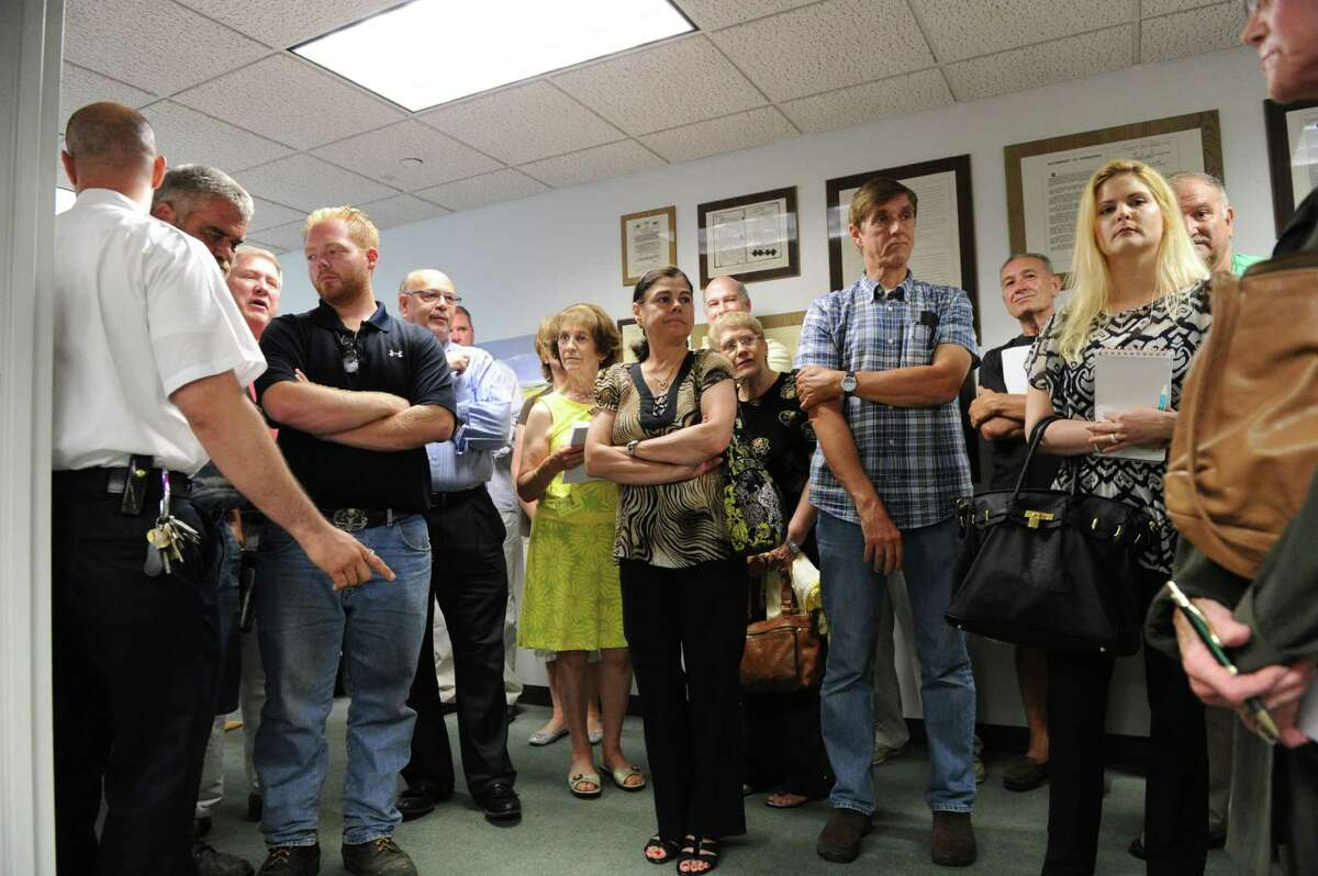 An overcapacity crowd gathered to hear the Board of Finance discuss a 2011 investigation into scrap metal theft by city workers from the city of Stamford. The workers involved were suspended at the time, but were later found to have done nothing wrong.