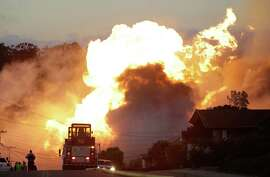 File - In this Sept. 9, 2010 file photo, a massive fire roars through a mostly residential neighborhood in San Bruno.