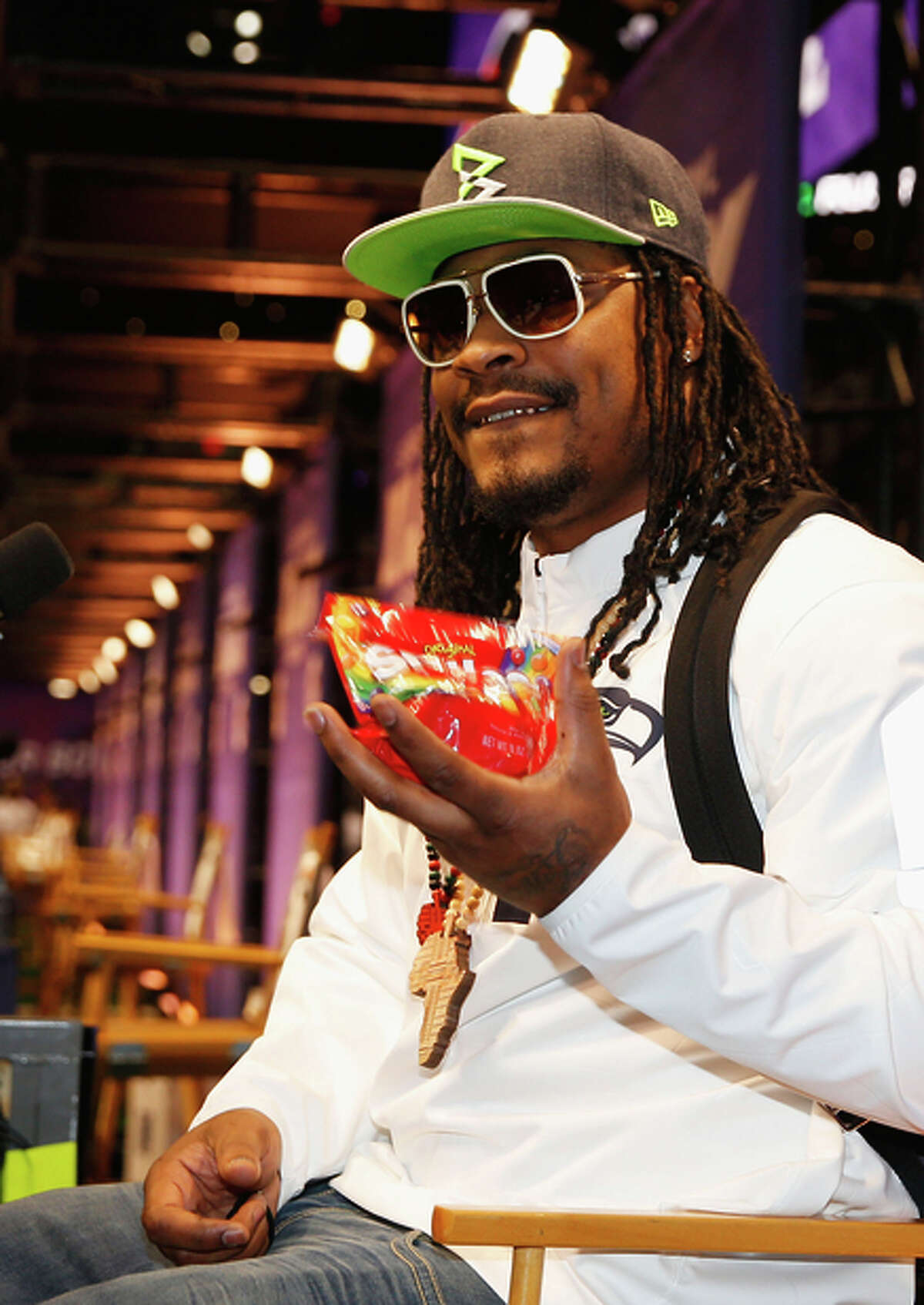 FILE --A Skittles ad has been a sweet success for Marshawn Lynch, who has been a fan of the candy since his early football days. Skittles now has launched a limited edition version of the candy featuring Lynch on its wrapper.