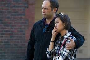 Two people, names not given, comfort each other following a four-alarm building fire in the 1500 block of McAllister Street, Saturday, Jan. 31, 2015, in San Francisco, Calif. The pair said they live in the building but were not inside when the fire broke out.