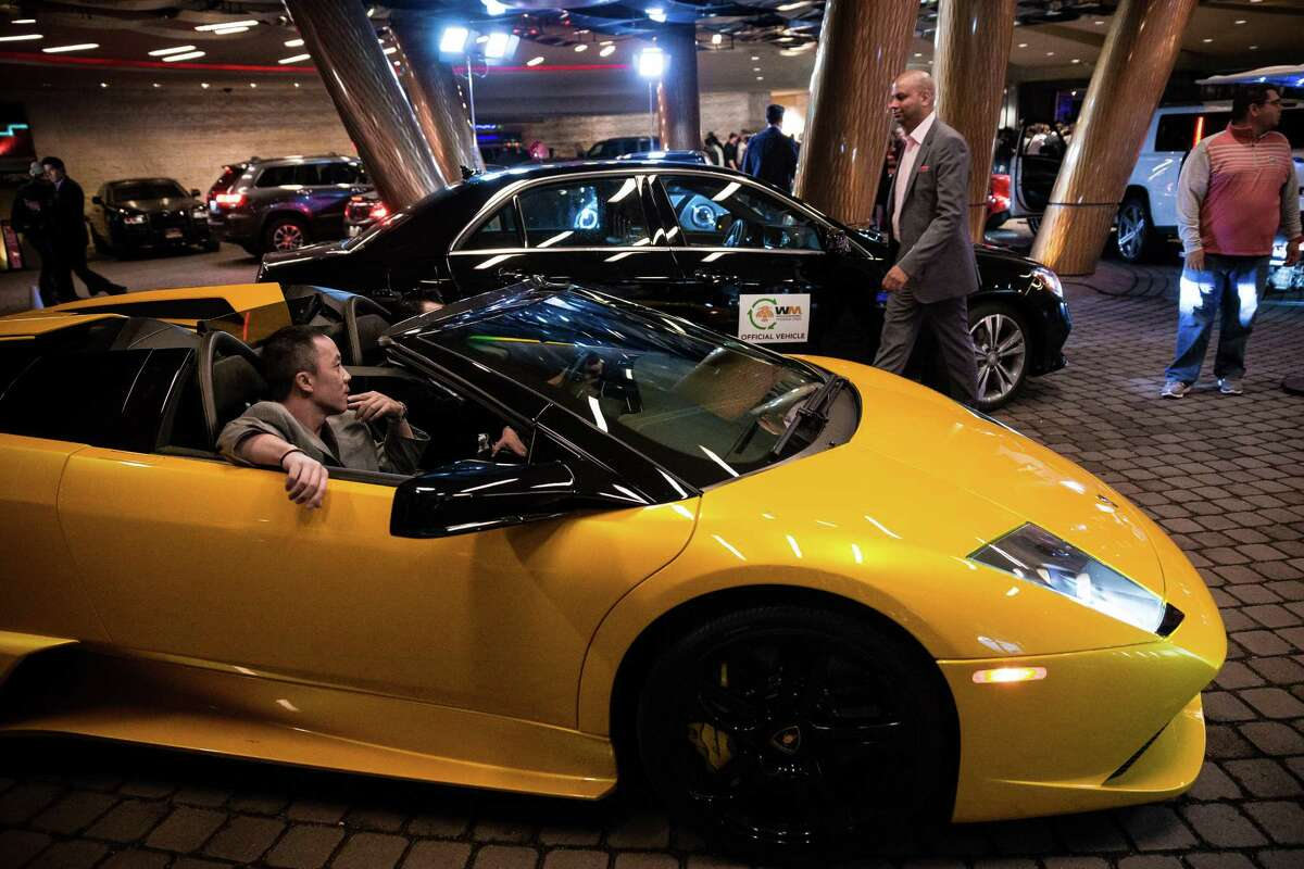 An array of expensive cars pull in to valet at The Super Bowl Playboy Party January 30, 2015, at the W Scottsdale in Scottsdale, Arizona. Nelly hosted the A-list event, complete with open bars for attendees. Celebrities such as Kanye West, Usher, and Lil John have all made past appearances at the Super Bowl Playboy Party to perform live.