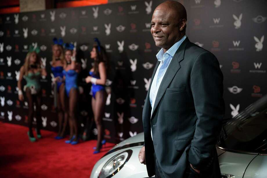An executive assistant to Warren Moon, pictured here, filed a lawsuit Monday, alleging him of sexual 