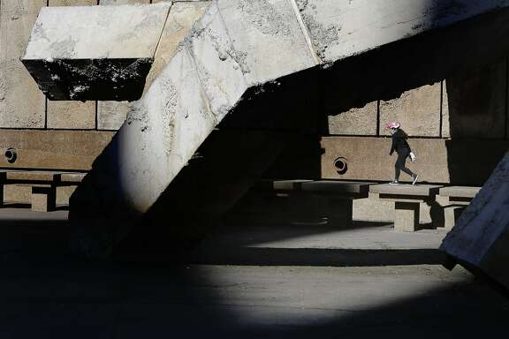 Angelina Sabillon, 9 of San Francisco climbs on the Vaillancourt Fountain at Justin Herman Plaza which is dry during the current drought as seen in San Francisco, Ca. on Saturday Jan. 31, 2015. The city of San Francisco closes out the month of January 2015 without a drop a rain, which is the first time ever since records have been kept.