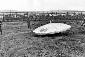3 National Guardsmen and flying saucer in vacant lot near Bay Farm island. April 8, 1950  UFOS  From the Chronicle Archive Library  Ran on: 06-26-2005 Is this a spacecraft? Yes or no, more sightings are being reported.