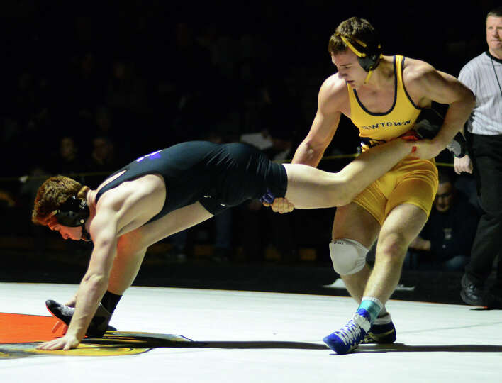 Newtown's Anthony Falbo, standing, wrestles against Kendal Elfstrum, of Monroe Woodbury, during the