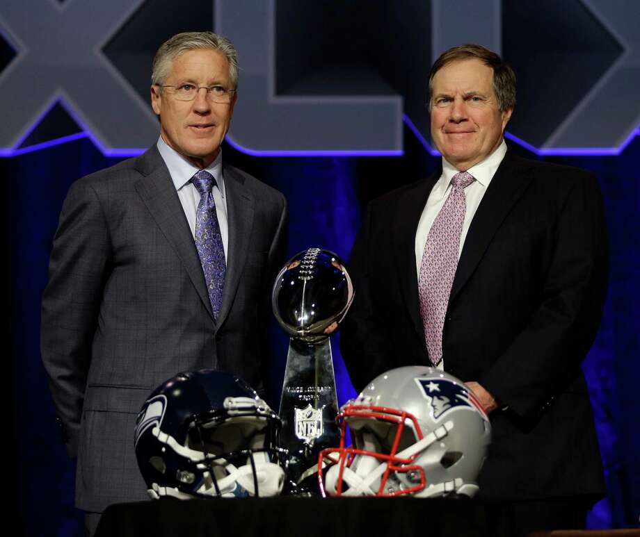Seattle Seahawks head coach Pete Carroll, left, and New England Patriots head coach Bill Belichick participate in a news conference for NFL Super Bowl XLIX football game Friday, Jan. 30, 2015, in Phoenix. (AP Photo/David J. Phillip) Photo: David J. Phillip, STF / AP
