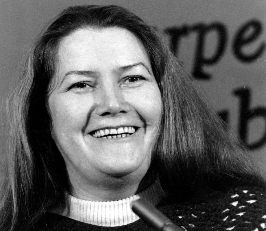 """FILE - In this March 1, 1977 file photo, Australian author Colleen McCullough laughs during a news conference in New York. Australia's largest newspaper was facing sharp criticism over its obituary of the nation's most famous author, whom the paper described as plain and overweight. The Australian newspaper's obituary of Colleen McCullough, whose novel """"The Thorn Birds"""" sold 30 million copies worldwide and who died on Thursday, Jan. 29, 2015 at age 77 after a long illness, opened not with a list of her myriad accomplishments, but with a description of her appearance. (AP Photo/File) Photo: STR / AP"""