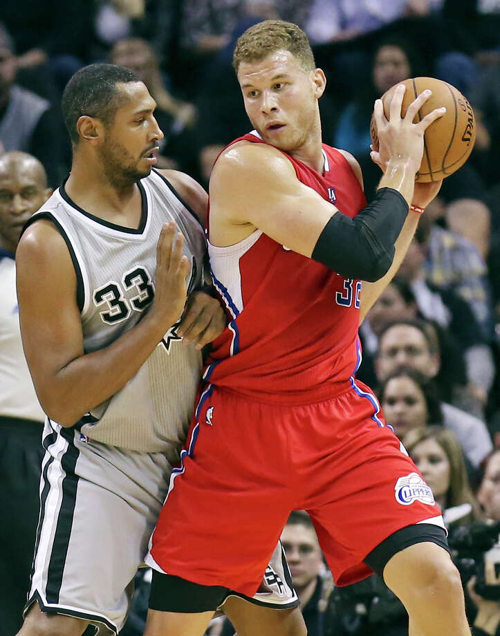 San Antonio Spurs' Boris Diaw defends Los Angeles Clippers' Blake Griffin during first half action Saturday Jan. 31, 2015 at the AT&T Center. Photo: Edward A. Ornelas, Staff / San Antonio Express-News / © 2015 San Antonio Express-News
