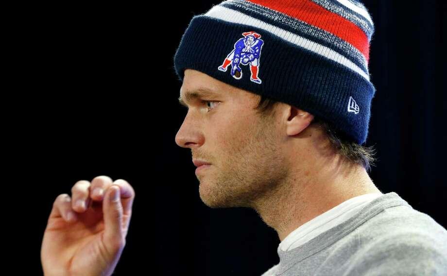 "Admittedly ""the biggest 49er fan growing up,"" Patriots QB Tom Brady can match boyhood idol Joe Montana by picking up a third Super Bowl MVP. Photo: Elise Amendola, STF / AP"