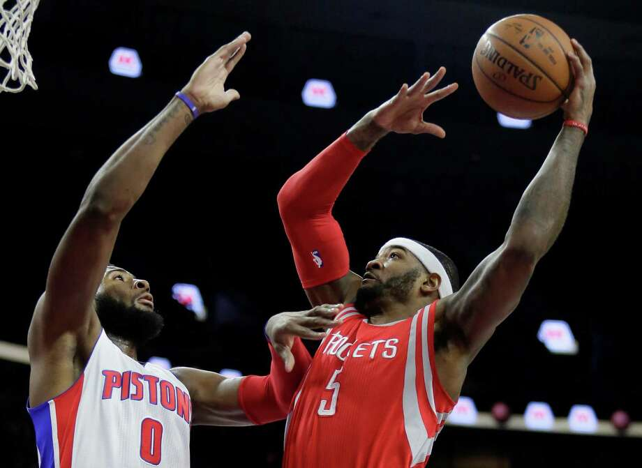 The Rockets' Josh Smith, right, goes to the basket against Andre Drummond of the Pistons, his former team. Smith had seven points off the bench. Photo: Duane Burleson, FRE / FR38952 AP
