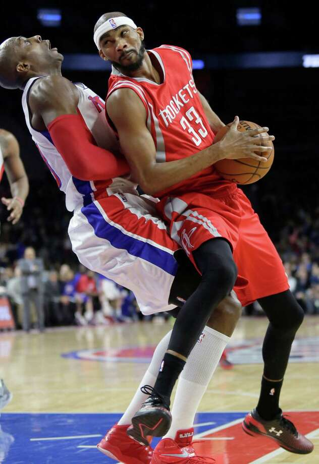 Corey Brewer collides with the Pistons' Anthony Tolliver while driving to the basket during the Rockets' loss at Detroit. Brewer had 10 points. Photo: Duane Burleson, FRE / FR38952 AP
