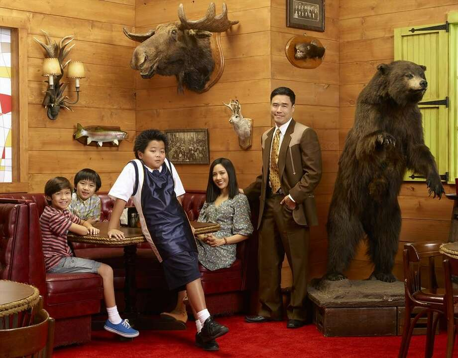 """Based on chef Eddie Huang's memoir, """"Fresh Off the Boat"""" is a nostalgic look at an immigrant family living in 1990's Orlando. Photo: Bob D'Amico, ABC / © 2014 American Broadcasting Companies, Inc. All rights reserved."""