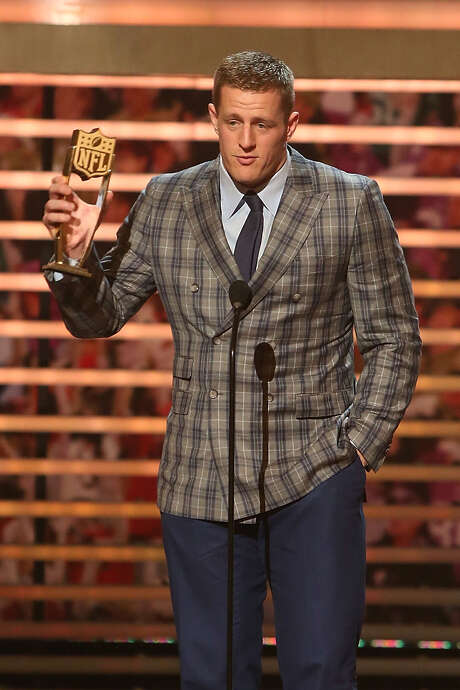 J.J. Watt adds to his riches by taking ownership of his second NFL Defensive Player of the Year trophy Saturday night at the Phoenix Convention Center. Photo: Taylor Hill, Contributor / 2015 Taylor Hill