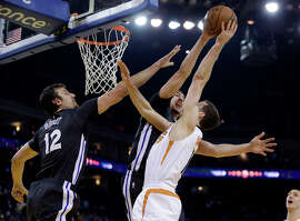 Klay Thompson blocks a shot by the Suns' Goran Dragic as teammate Andrew Bogut comes over to help. The Warriors' defense toughened up after Phoenix established a double-digit lead in the second quarter.