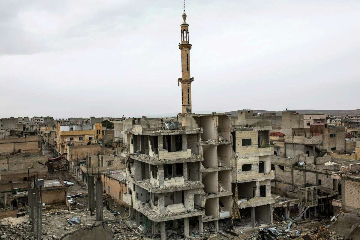 In this picture taken Friday, Jan. 30, 2015, rubble and damaged buildings are seen in the devastated Syrian city of Ain al-Arab, also known as Kobani. The Islamic State group has acknowledged for the first time that its fighters have been defeated in the Syrian town of Kobani and vowed to attack the town again.