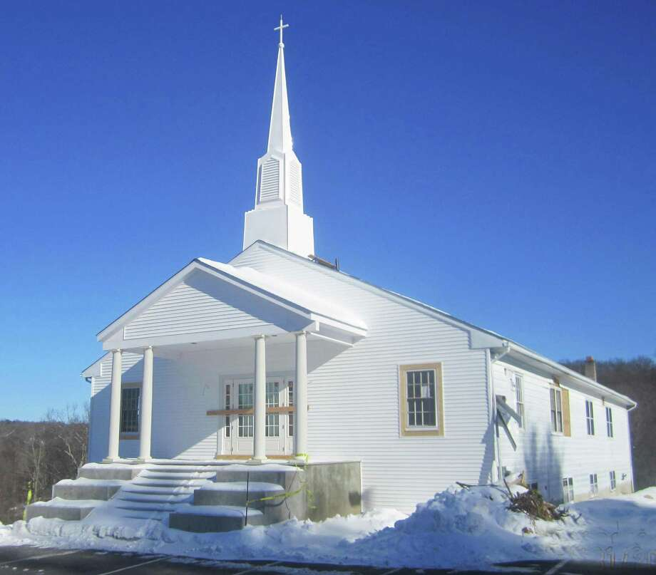 The Walnut Hill Community Church along Dorwin Hill in New Milford sparkles in a bright, mid-winter's sun as months of renovations and improvements draw near to a finish.January 2015 Photo: Norm Cummings / The News-Times