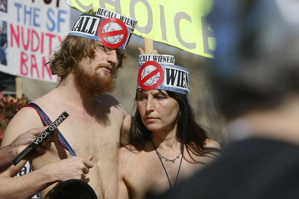 James Taub and Gypsy Taub stand in Jane Warner Plaza in the Castro District of San Francisco, Calif. during a protest against San Francisco's no-nudity law held on the ban's second anniversary Sunday, February 1, 2015.