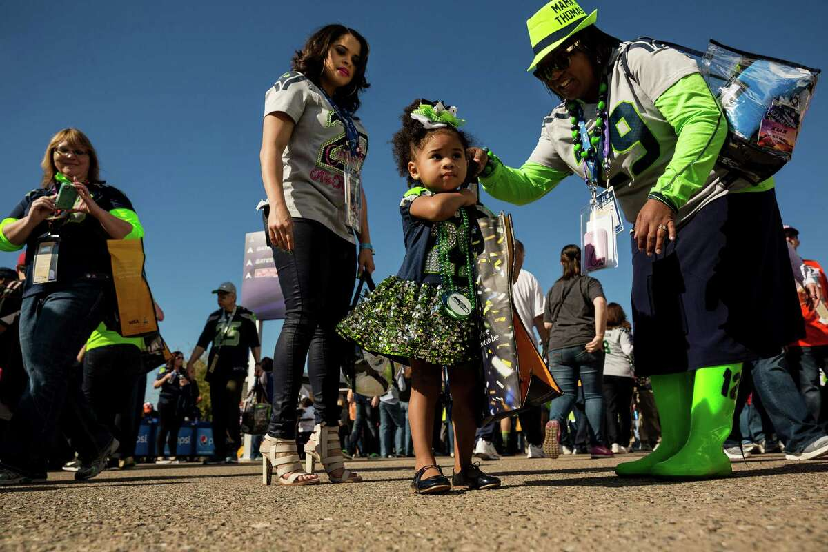 Kaleigh Rose, center, daughter of Seahawks player Earl Thomas, prepares to enter the stadium before the kickoff of Super Bowl XLIX Sunday, February 1, 2015, at University of Phoenix Stadium in Glendale, Arizona.