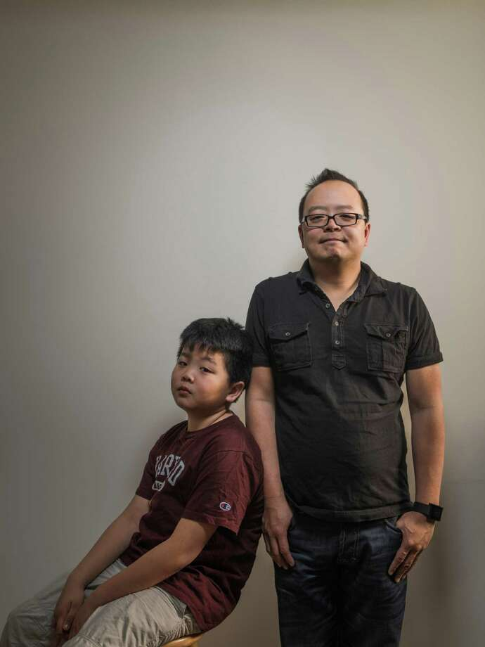 "-- PHOTO MOVED IN ADVANCE AND NOT FOR USE - ONLINE OR IN PRINT - BEFORE FEB. 1, 2015. -- Hudson Yang, the young star of the ABC sitcom a€œFresh Off the Boat,a€ with his father, the cultural critic Jeff Yang, at their apartment in New York, Jan. 21, 2015. Much is riding on ""Fresh Off the Boat,"" based on a memoir by the chef Eddie Huang and the first sitcom about an Asian-American family since Margaret Cho's short-lived show of the 1990s. (Sasha Maslov/The New York Times) ORG XMIT: XNYT68 Photo: SASHA MASLOV / XNYT"