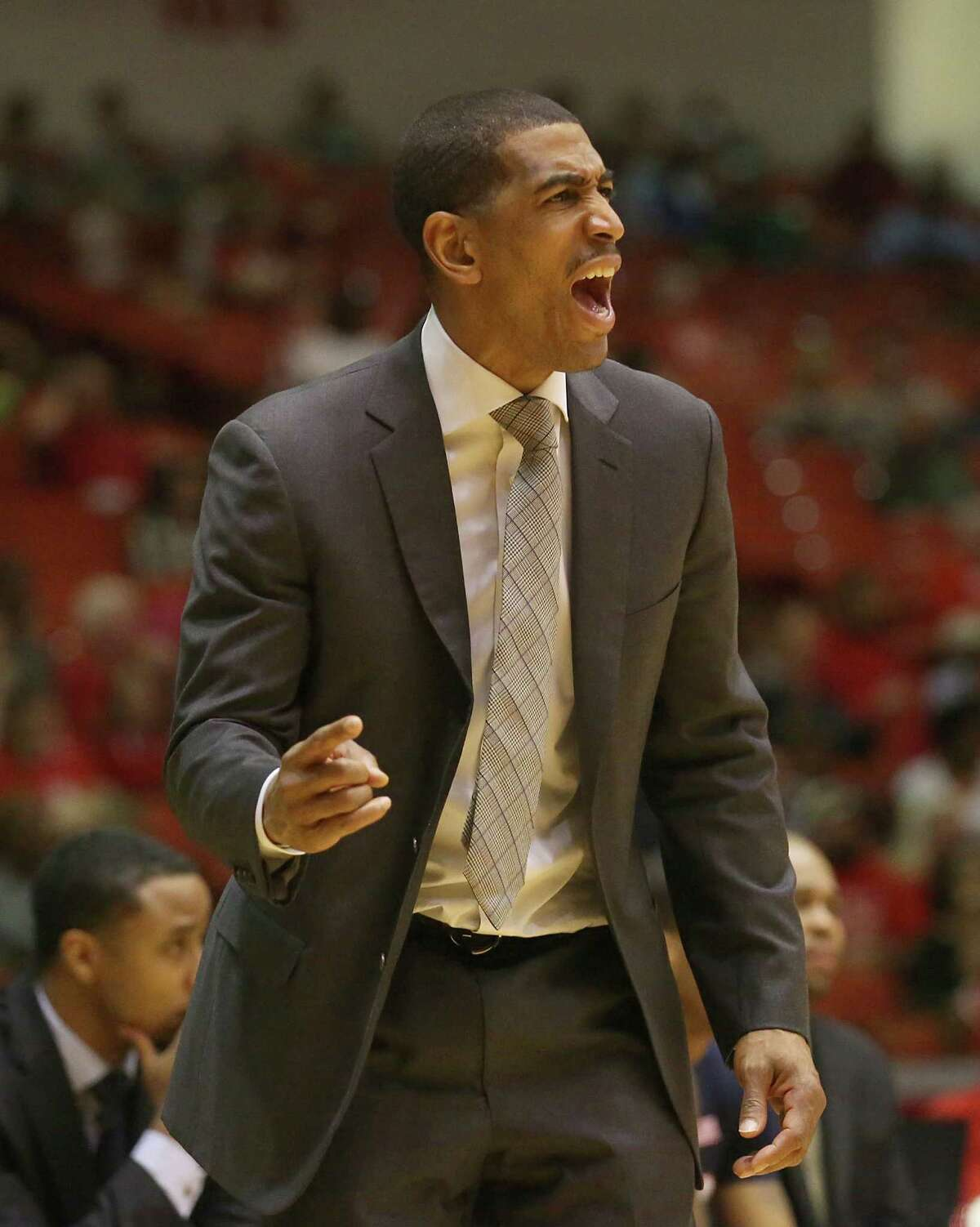 Connecticut Huskies head coach Kevin Ollie argues a call while playing the Houston Cougars in the first half in a NCAA basketball game on Sunday, February 1, 2015 at Hofheinz Pavilion in Houston, TX.