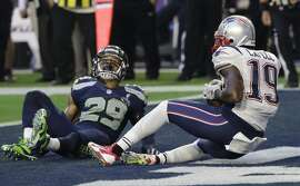 New England Patriots wide receiver Brandon LaFell (19) catches an 11-yard touchdown pass in front of Seattle Seahawks free safety Earl Thomas (29) during the first half of NFL Super Bowl XLIX football game Sunday, Feb. 1, 2015, in Glendale, Ariz. (AP Photo/David J. Phillip)