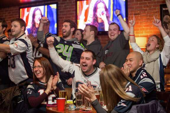 BOSTON, MA - FEBRUARY 1:  New England Patriots fans celebrate during the opening ceremony of Super Bowl XLIX at Jerry Remy's Sports Bar February 1, 2015 in Boston, Massachusetts. The Patriots and Seattle Seahawks square off in this year's matchup.