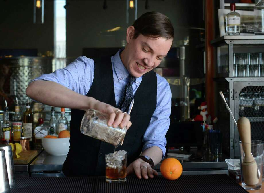 Nicholas Kenna is the bartender at Dorćol Distilling Co, the first distillery in the San Antonio area to hire a bartender. Photo: Billy Calzada /San Antonio Express-News / San Antonio Express-News