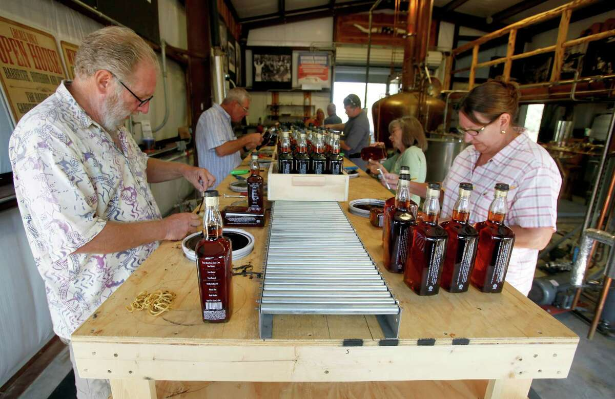 Randy, left, and Debbie Garst of Dripping Springs help bottle at Garrison Brothers in Hye.