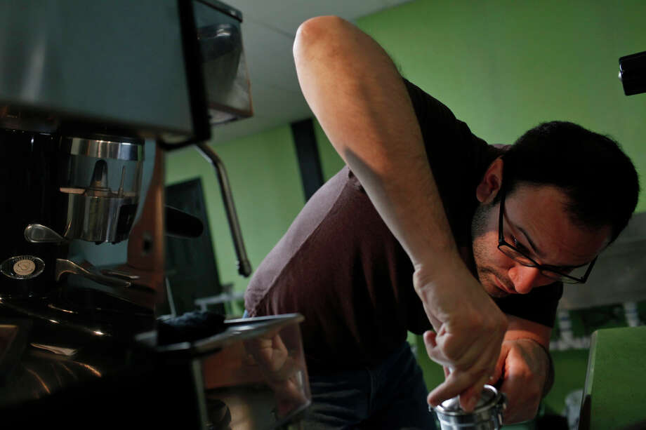 Aaron Blanco, owner of The Brown Coffee Co., makes a Cortave, made with espresso, agave nectar and milk. Photo: Lisa Krantz /San Antonio Express-News / SAN ANTONIO EXPRESS-NEWS