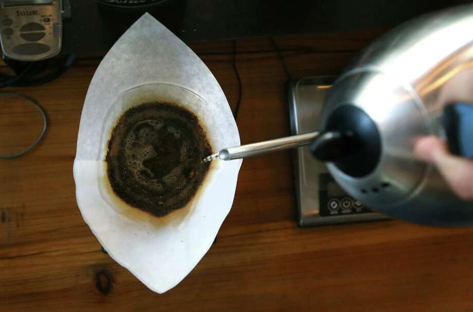 A slow pour coffee Photo: Bob Owen /San Antonio Express-News / © 2014 San Antonio Express-News