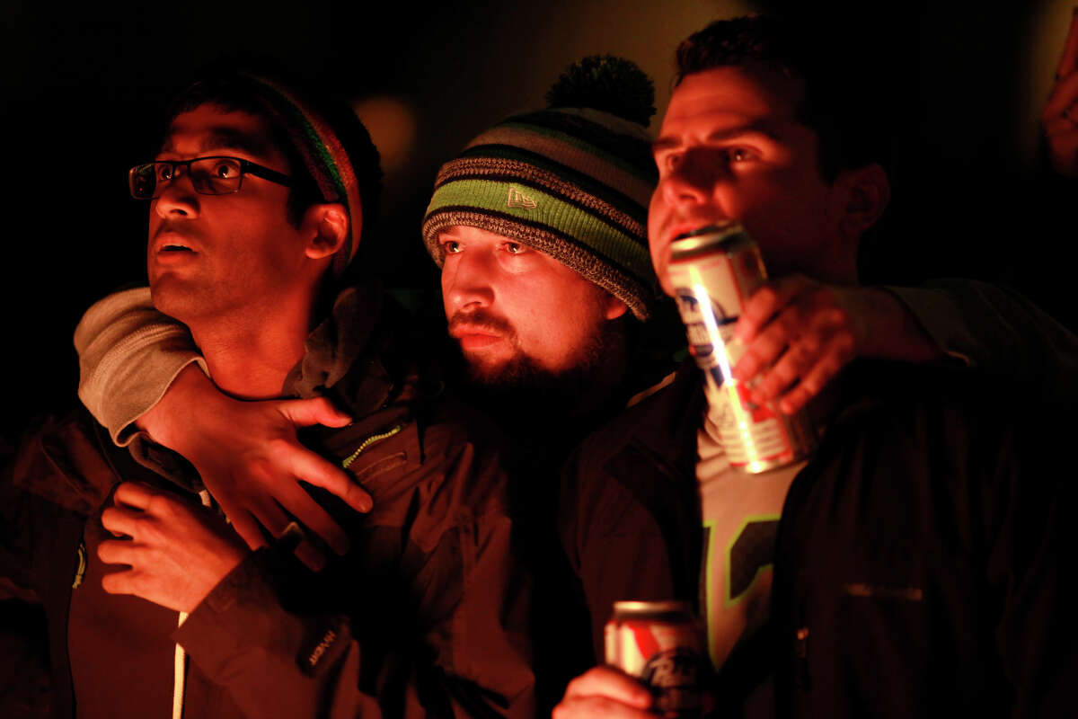 Zach McNair, center, watched the final minutes of the game in Pioneer Square during Super Bowl XLIX on Sunday, Feb. 1, 2015 in Seattle, Wash.